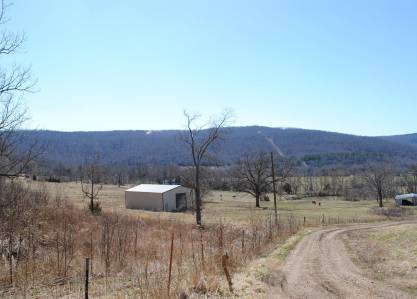 Newer barn/shop with fenced pasture. Property is left of road