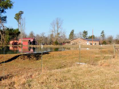 Large home on 6+/- acres with metal barn, 2 ponds. Property is fenced and cross fenced